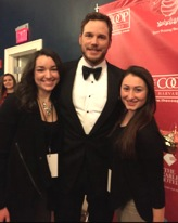 Chris Pratt, Hasty Pudding's Man of the Year, poses with Watertown High School student reporters working for the Raider Times newspaper, at the Man of the Year roast on Feb. 6, 2015.