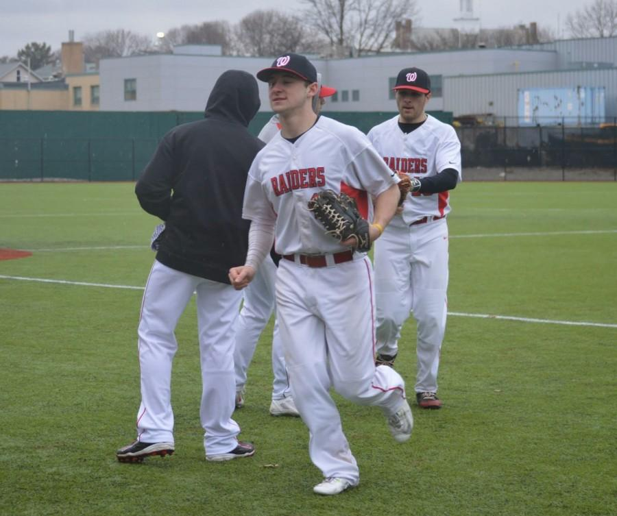 Austin Farry, shown in Watertown's season opener, scored the Raiders' go-ahead run and added an RBI single, but it was not enough as Arlington High dropped WHS to 0-2 with a 7-3 decision on Thursday, April 9, at Victory Field.
