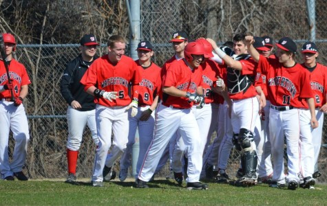 Brendan Berkeley (12, wearing helmet) is congratulated after homering during Watertown's 10-8 Middlesex League victory in Winchester on Monday, April 13.