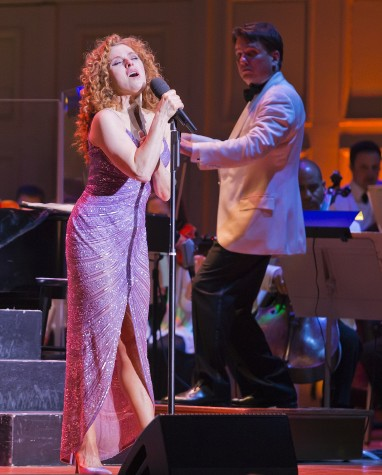 Bernadette Peters (left) helps Keith Lockhart celebrate his 20th year conducting the Boston Pops during a concert at Symphony Hall in Boston on Wednesday, May 6, 2015.