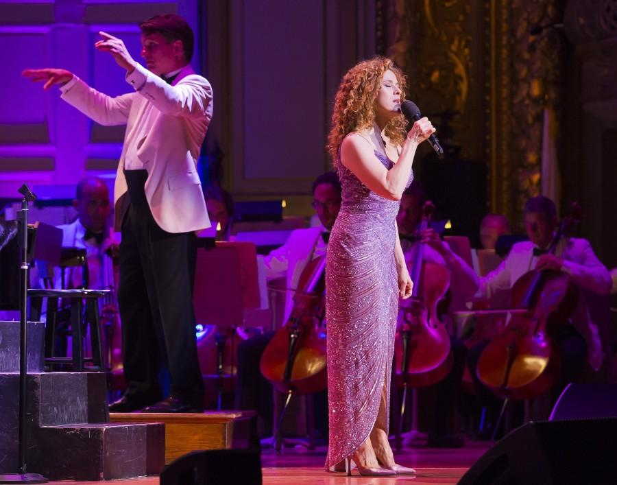 Bernadette+Peters+%28right%29+helps+Keith+Lockhart+celebrate+his+20th+year+conducting+the+Boston+Pops+during+a+concert+at+Symphony+Hall+in+Boston+on+Wednesday%2C+May+6%2C+2015.