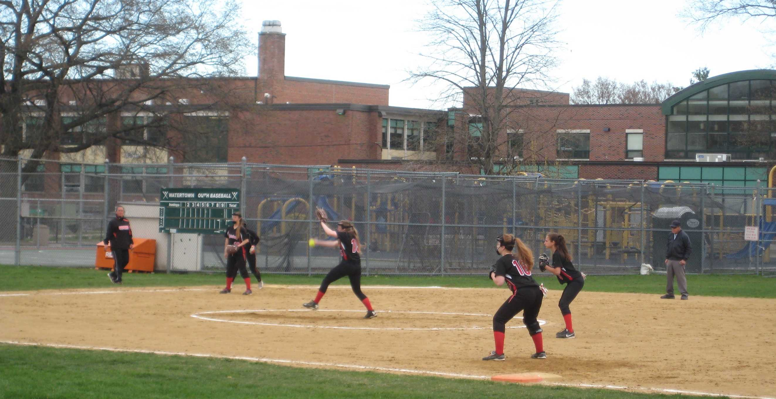 Freshman pitcher Destiny Santalucia winds up during a recent Watertown High School softball game, played on its home field at Hosmer  Elementary School.