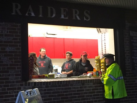 Parents of younger Watertown High football players work at the Victory Field snack shack during football games.