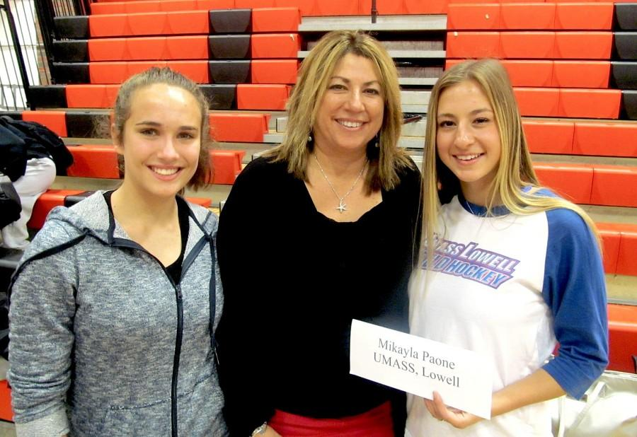 Mikayala Paone (right) poses with family members after her letter of intent signing ceremony in the Watertown High gym on Thursday, Nov. 12, 2015. Paone will be playing field hockey for UMass-Lowell.