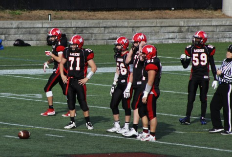 The Raiders defensive line -- Jake Leitner (71), Barry Dunn (56), Alec Campbell (77), and Erick Yax-Vidal (61) -- wait for the Marauders to come to the line at Victory Field on Thanksgiving. (Nov. 26, 2015).