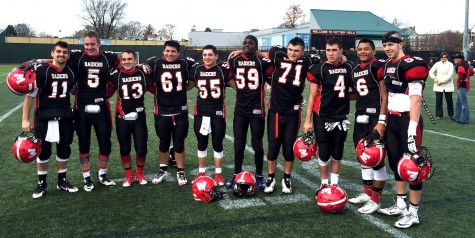 Watertown High seniors pose on Victory Field after playing their last football game for the Raiders, a 24-22 victory over Belmont on Thanksgiving. From left: Dan Farrar, Kyle Foley, Robert Kennedy, Erick Yax-Vidal, Stevie Mey, Farid Mawanda, Jake Leitner, Tyler Poulin, Luis Moradel, and Barry Dunn. (Nov. 26, 2015)