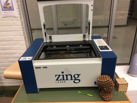 The laser cutter is one of the pieces of equipment in the new Fab Lab in the Watertown High library.
