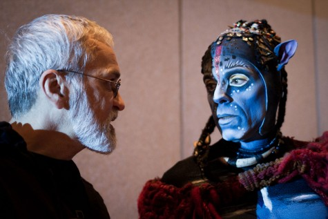"""Cirque du Soleil director Michel Lemieux (left) has a close-up view of the intricate makeup and design worn by the performers in the new production, """"Toruk: The First Flight."""""""