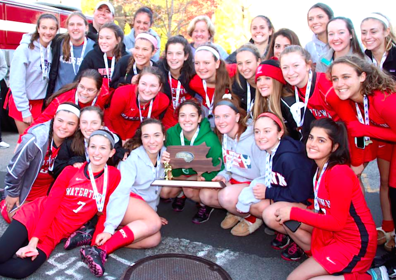 Members+of+the+Watertown+field+hockey+team+celebrate+after+winning+the+MIAA+Division+2+state+championship+on+Saturday%2C+Nov.+21%2C+2015%2C+in+Worcester.+The+Raiders+beat+Auburn%2C+6-0%2C+for+their+seventh+straight+MIAA+state+championship+while+extending+their+national-record+unbeaten+streak+to+160+games.