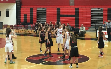 Tipoff at the Watertown High girls' basketball home opener vs. Winchester on Friday, Dec. 18, 2015.