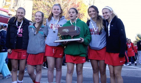 The seniors on the 2015 Watertown field hockey team celebrate at the high school after winning the MIAA Division 2 state championship on Saturday, Nov. 21, in Worcester. The Raiders beat Auburn, 6-0, for their seventh straight MIAA state championship while extending their national-record unbeaten streak to 160 games.