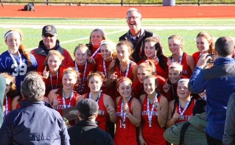 Members of the Watertown field hockey team celebrate after winning the MIAA Division 2 state championship on Saturday, Nov. 21, 2015, in Worcester. The Raiders beat Auburn, 6-0, for their seventh straight MIAA state championship while extending their national-record unbeaten streak to 160 games.
