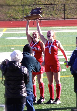 Captains Michaela Antonellis (left) and Ally McCall celebrate with their trophy after the Watertown field hockey team won the MIAA Division 2 state championship on Saturday, Nov. 21, 2015, in Worcester. The Raiders beat Auburn, 6-0, for their seventh straight MIAA state championship while extending their national-record unbeaten streak to 160 games.