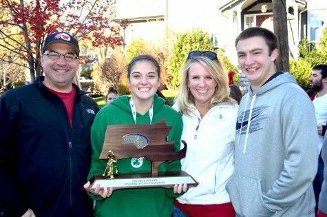 Michaela Antonellis celebrates with her family after the Watertown field hockey team won the MIAA Division 2 state championship on Saturday, Nov. 21, 2015, in Worcester. The Raiders beat Auburn, 6-0, for their seventh straight MIAA state championship while extending their national-record unbeaten streak to 160 games.