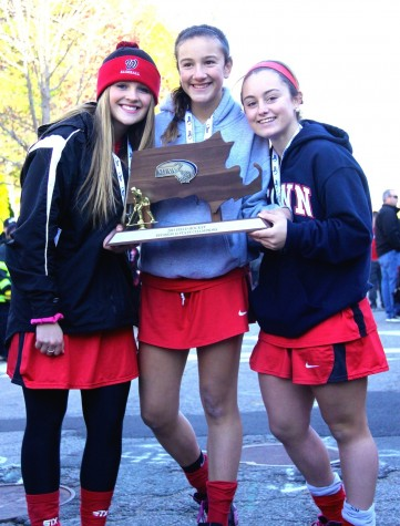 Members of the Watertown field hockey team celebrate at the high school after winning the MIAA Division 2 state championship on Saturday, Nov. 21, 2015, in Worcester. The Raiders beat Auburn, 6-0, for their seventh straight MIAA state championship while extending their national-record unbeaten streak to 160 games.