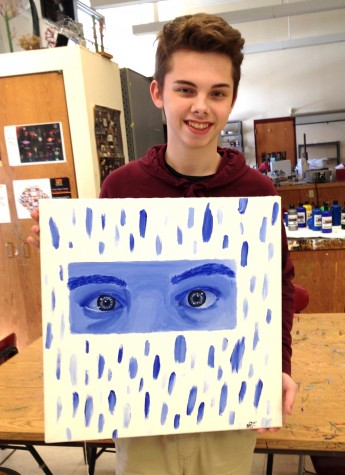 "Noah Prior of the Watertown High studio art class poses with his work that will be displayed in the show ""Here I Am"" at Room 83 Spring Gallery in Watertown, Mass., from Feb. 4-27, 2016."