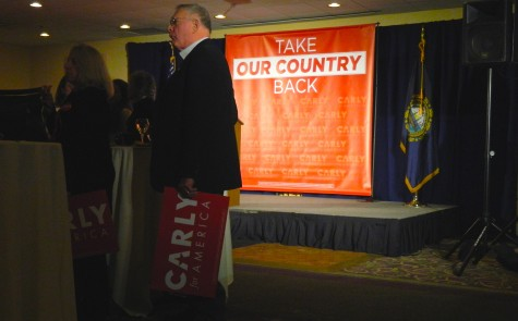 Supporters of Carly Fiorina wait for an appearance from the presidential candidate at Derryfield Country Club in Manchester, N.H., on Feb. 9, 2016, following the New Hampshire primary.