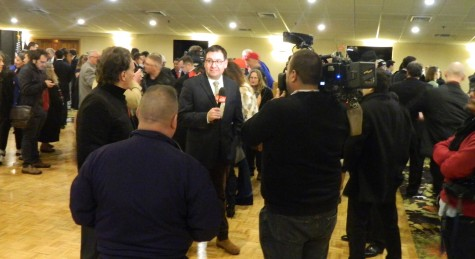 Reporters interview supporters following a speech by presidential candidate Donald Trump at the post-election party at Executive Court Banquet Facility in Manchester, N.H., on Feb. 9, 2016, following the New Hampshire primary.