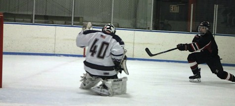 Nick Martino beats Belmont goalie Kevin Dacey in the second period as the Watertown hockey team took on the Marauders at Skip Viglirolo Skating Rink on Jan. 27, 2016.