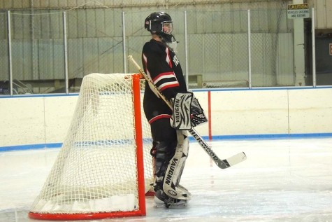 Watertown High goalie Jason Hughes has a moment to himself during the Raiders game against Belmont at Skip Viglirolo Skating Rink on Jan. 27, 2016.