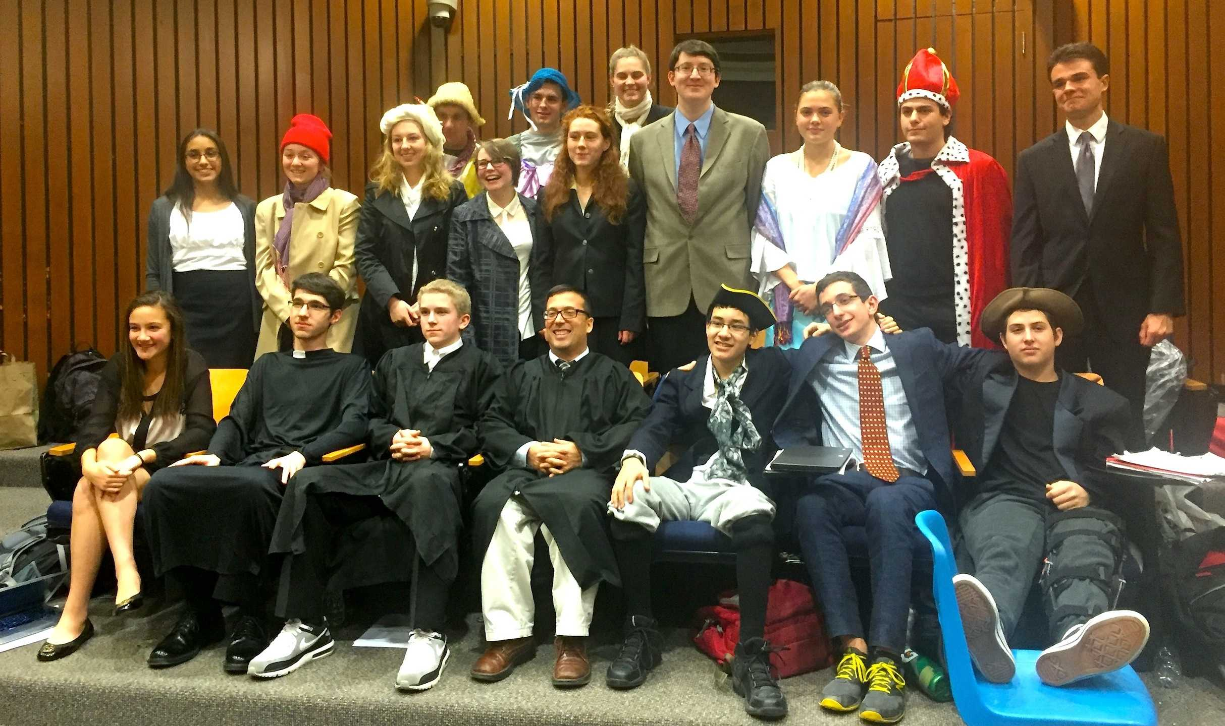 Participants in the annual French Revolution trial put differences aside to pose with Judge Mastro (front row, center) for a group picture in the Watertown High School lecture hall on Jan. 21, 2016.