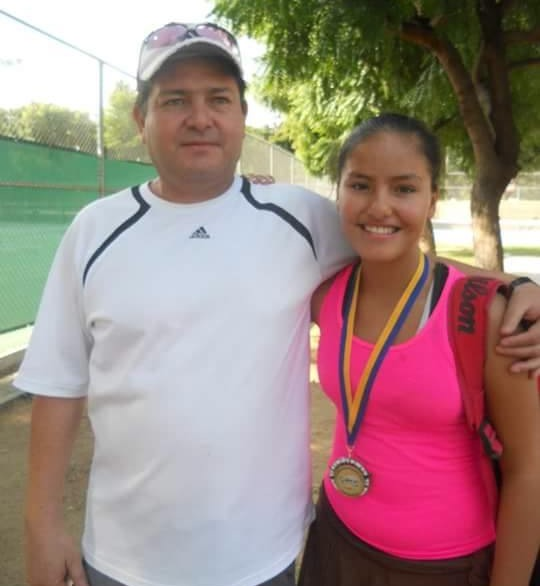 Lilian Marr Calderon, the newest member of the Watertown High tennis team, poses with her father in Mexico.