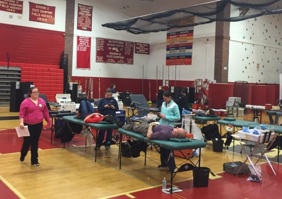 George+Hoffman%2C+in+purple+shirt%2C+was+one+of+the+46+people+who+donated+during+the+Red+Cross+blood+drive+inside+the+Watertown+High+gym+on+Thursday%2C+March+17%2C+2016.