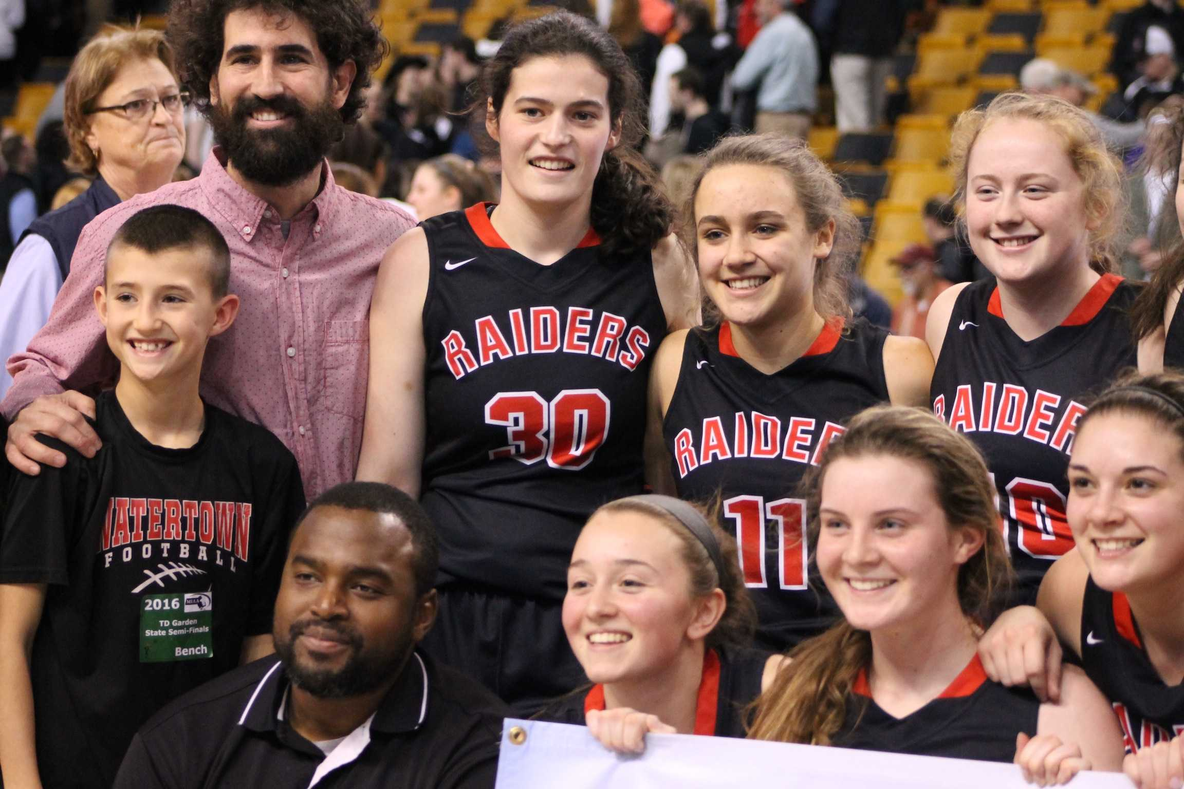 Coach Pat Ferdinand (bottom left) and the Watertown High girls' basketball team won the 2016 EMass title at TD Garden.