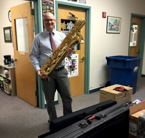 Dan Jordan -- who teaches music throughout the Watertown Public School system -- poses with some of the instruments purchased with the recent grant from Music Drives Us.