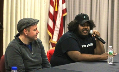 Michael Christmas (right) and Boston Calling Mike Snow address at panel of high school student reporters at the Boston Globe.