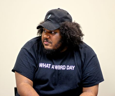 Michael Christmas, who will be performing at the 2016 Boston Calling Music Festival in May, listens to journalism students from Boston-area high schools during a music panel at the Boston Globe.