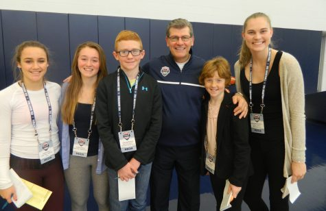 Geno Auriemma (third from right) poses with student reporters from Watertown, Mass., at the US Olympic women's basketball camp on Feb. 21, 2016, on the UConn campus.
