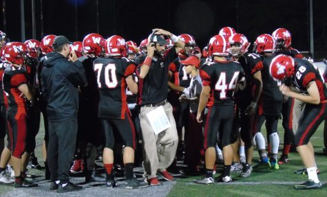 Coach John Cacace (center) led Watertown High against Wakefield in a Middlesex League football game at Victory Field on Sept. 23, 2016.