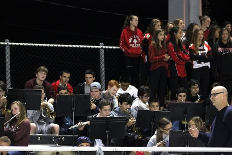 Dan Jordan (lower right) and the WHS Pep Band energized the Victory Field crowd as the Raiders beat Plymouth South, 24-6, on Sept. 16, 2016.