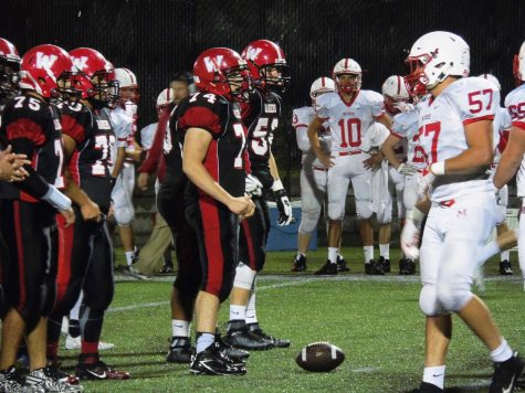James Walter (74) and Watertown High enjoyed a rainy Senior Night at Victory Field, defeating Melrose, 14-12, on Friday, Sept., 30, 2016.