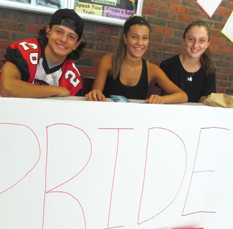 Members of Watertown High's Pride Committee sign up new members at the annual club fair