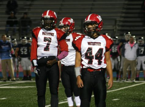 Deon Smith (7) and Matthew Muldrew (44) helped the Watertown High football team move its record to 5-1 with a 28-0 shutout of host Wilmington on Friday, Oct. 14, 2016.