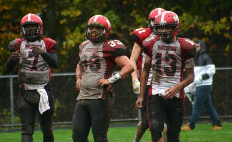 Deon Smith (7), Zach Rimsa (33), and Yoseph Hamad (13) got down and dirty to help Watertown beat host Stoneham, 16-8, in overtime on Saturday, Oct. 22, 2016. With the win, Raiders improved to 6-1 and earned a top seed in the MIAA Division 3 North playoffs.