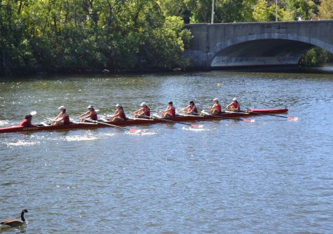 The novice girls competitive team from Community Rowing Inc. gets its work in on the Charles River.