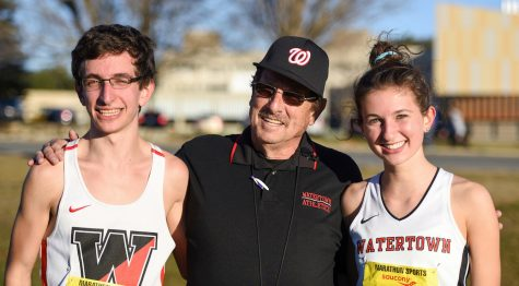 Watertown High senior James Piccirilli (left) and junior Emily Koufos (right) pose with Raiders coach Tom Wittenhagen at the Division 2 MIAA all-state cross-country meet Nov. 19, 2016, in Gardner.