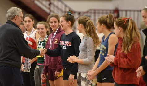 Watertown High junior Emily Koufos accepts her medal after finishing 12th in the Division 2 girls' MIAA all-state cross-country meet Nov. 19, 2016, in Gardner. She finished the 5K course in 19 minutes 48 seconds.