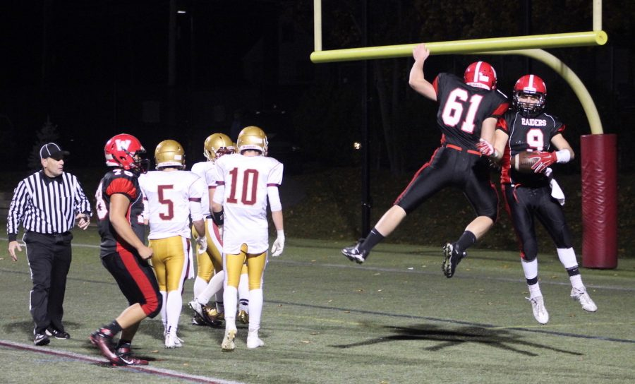 Frankie Hession (61) and Vasken Kebabjian (No. 9) celebrate a touchdown during Watertowns 27-10 win over visiting Newburyport in the Division 3 North semifinals on Friday night, Nov. 4, 2016.