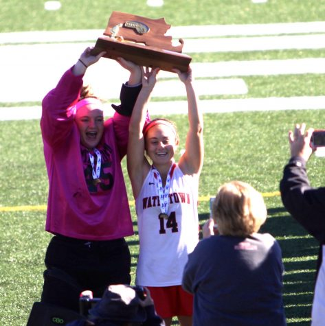Jonna (left) and Kourtney Kennedy celebrate after Watertown defeated Oakmont, 4-3, for the MIAA Division 2 state championship Nov. 19, 2016, at WPI.