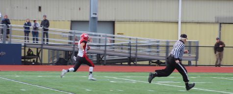 Vasken Kebabjian takes off for one of his three touchdown runs during Watertown's 34-28 victory at Thanksgiving rival Belmont on Nov. 24, 2016.