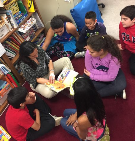 Helda Shirinian (reading) leads the STAR program for ELL students three times a week after school at Cunniff Elementary in Watertown, Mass.