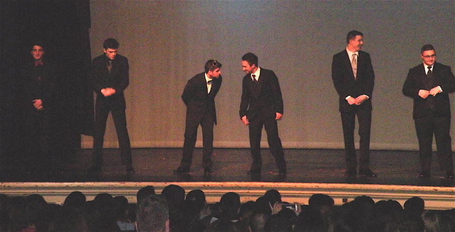 The competitors for Mr. WHS 2016 -- (from left) Mark Amirbekyan, Ryan Clancy, Danny Farrar, Robert Kennedy, John Korte, and Hovig Margosian --await the judges' final results on March 31, 2016, at Watertown High School.