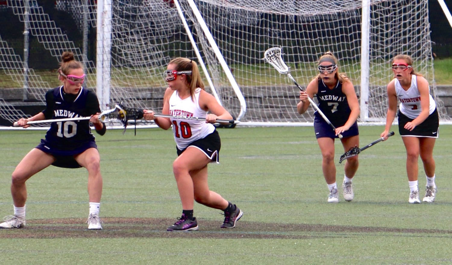 The Watertown High girls' lacrosse team (in white) takes on Medway in an MIAA East Division 2 tournament game at Victory Field on Tuesday, May 30, 2017. The host Raiders (11-6) fell to Medway (12-6) in the first-round game, 10-4.