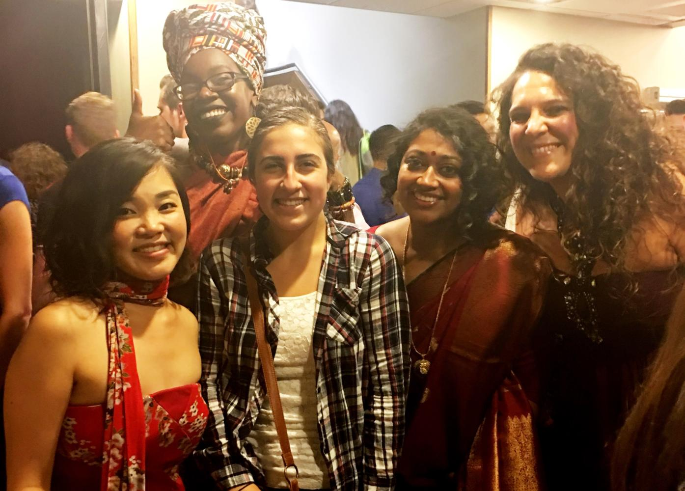 A Raider Times reporter poses in the middle of the a cappella group Women of the World -- from left, Ayumi Ueda, Deborah Pierre, Annette Philip, and Giorgia Renosto -- at the A Cappella Open national semifinals at Berklee Performance Center on July  29, 2017.