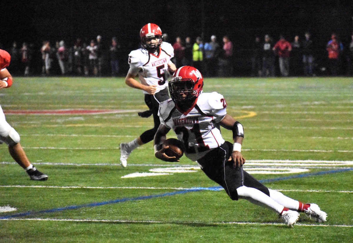 (Third picture of three) Mange Camara (21) cuts hard with his pass reception during Watertown's 28-14 loss at Melrose on Friday, Sept. 22, 2017. The Raiders return to Victory Field on Thursday, Sept. 28, for a 7 p.m. game with Burlington.