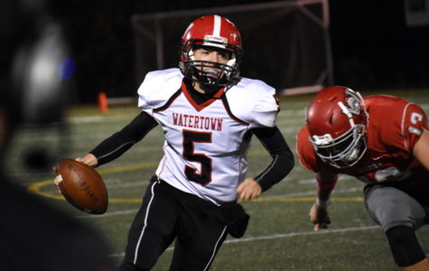 Watertown quarterback Nick McDermott races for the sideline with a Wakefield defender in pursuit. Watertown played at Wakefield on Friday, Oct. 20, 2017, losing to the host Warriors, 21-14, in the last game before the MIAA playoffs.